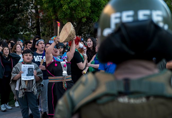 Students and Mapuche activists protest in Santiago, demanding the resignation of Chile's Interior Minister Andres Chadwick, following the death of a young Mapuche man during a police operation.