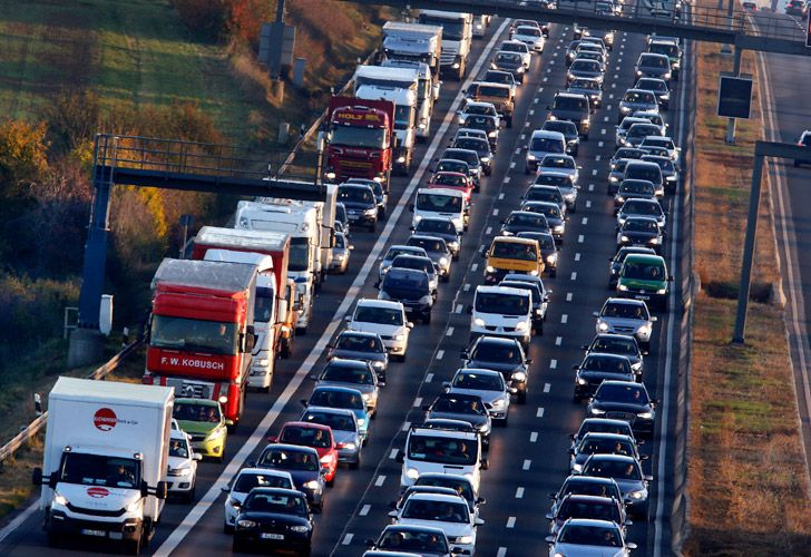 Cars and trucks queue on the highway A5 in Frankfurt, Germany.