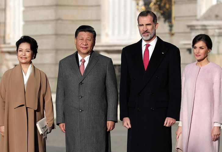 Chinese President Xi Jinping poses with Spain's King Felipe together with their wives during a welcome ceremony at the Royal Palace in Madrid, Spain.
