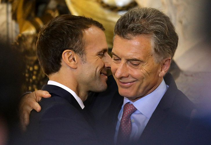 France's President Emmanuel Macron (left) hugs Mauricio Macri during a press conference at the Casa Rosada this morning.