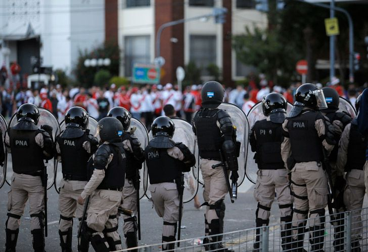 River Plate face riot police outside the Monumental last Saturday.