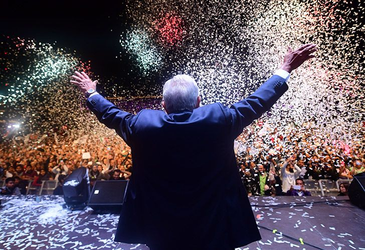 In this July 2018 photo, Andres Manuel López Obrador waves at supporters at Zocalo Square after winning Mexico's general elections.