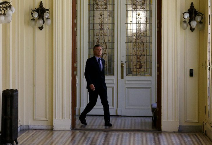 Argentina's President Mauricio Macri arrives for an interview with The Associated Press at the presidential palace in Buenos Aires, Argentina, Monday, Dec. 3, 2018.