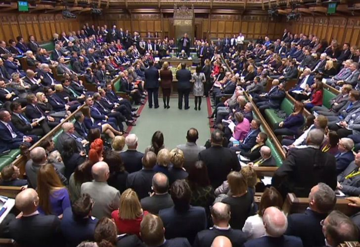 A video grab from footage broadcast by the UK Parliament's Parliamentary Recording Unit (PRU) shows MPs in the House of Commons as the outcome of a vote on an amendment introduced by Conservative MP Dominic Grieve to the timetabling motion for the Brexit deal debate in the House of Commons in London on December 4, 2018 is announced.