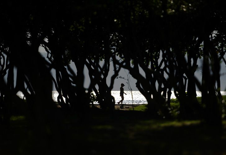 A woman walks at a park in Rio de Janeiro, Brazil.