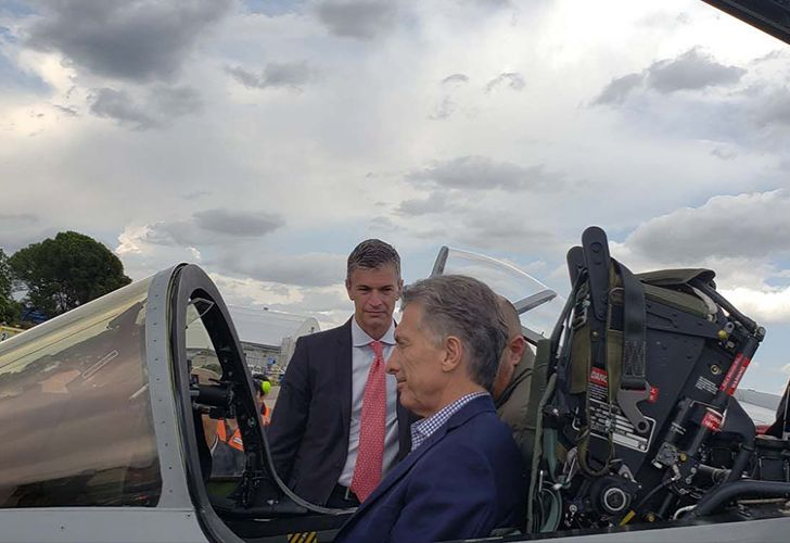 President Mauricio Macri sits inside an Argentine-made IA 63 Pampa III jet fighter.