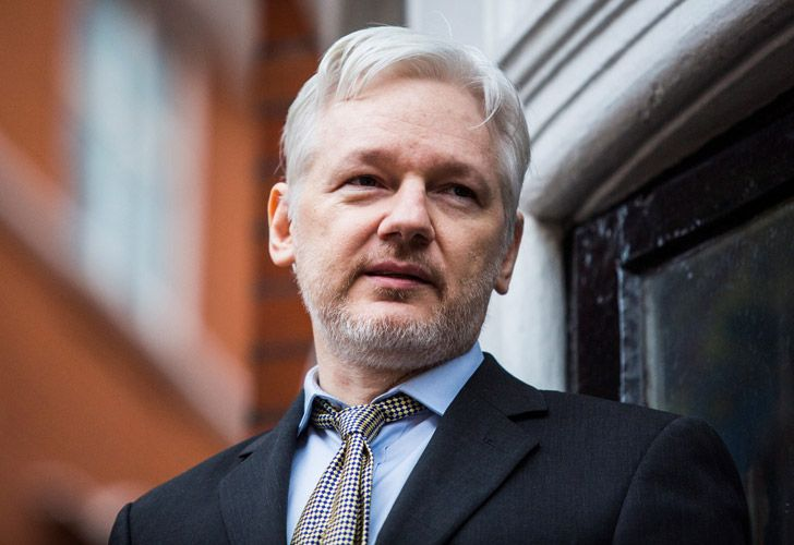 WikiLeaks founder Julian Assange addressing the media from the balcony of the Ecuadorian embassy in February 2016 in central London.