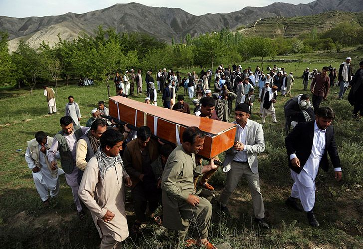 In this April 30, 2018 file photo, relatives, colleagues and friends of AFP chief photographer, Shah Marai, who was killed that day in a second suicide attack, carry his coffin in his village.