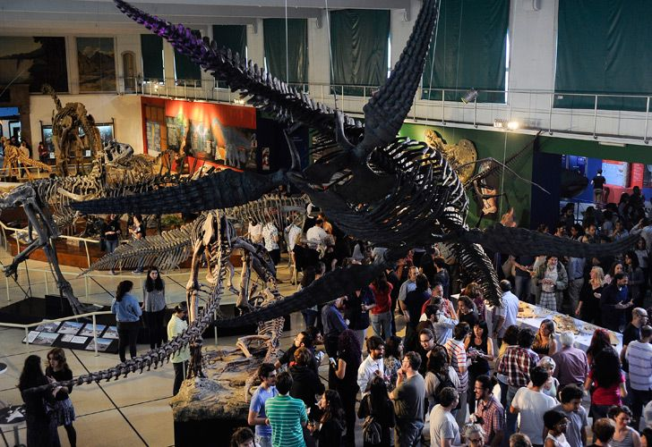 People attend the exhibition inauguration of a skeleton of a giant plesiosaurus (Reptilia, Sauropterygia), an extinct marine reptile discovered in cretaceous rocks near El Calafate, Santa Cruz province.