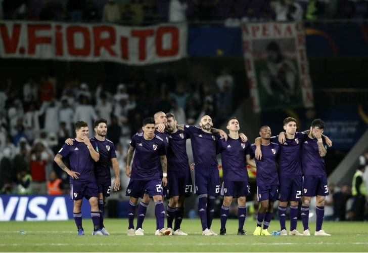 River Plate's players react after the penalty shoot-out loss in the Club World Cup semi-final against Al Ain Club at the Hazza Bin Zayed stadium in Al Ain, United Arab Emirates.