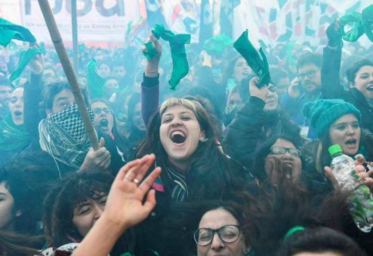 Hundreds of thousands of green pro-choice activists burst into cheers and tears on the streets outside Congress.