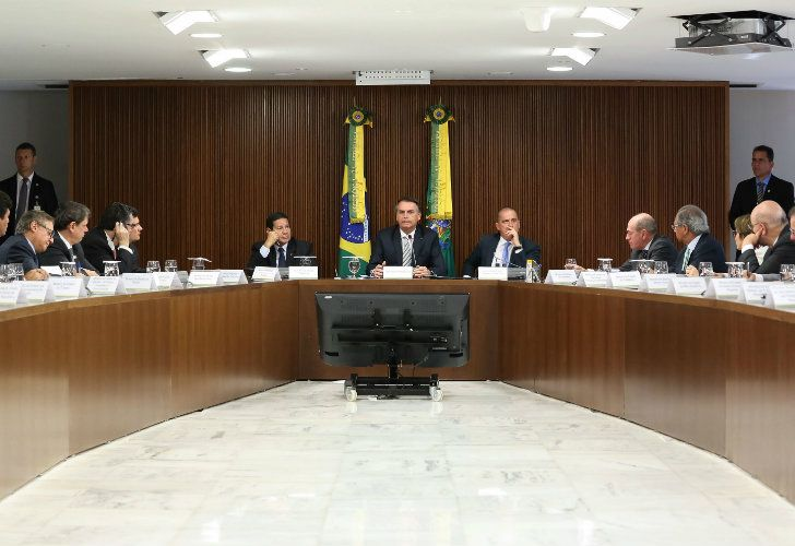 Brazilian President Jair Bolsonaro (centre) attends a ministerial meeting at the Planalto Palace in Brasilia on January 3, 2019.