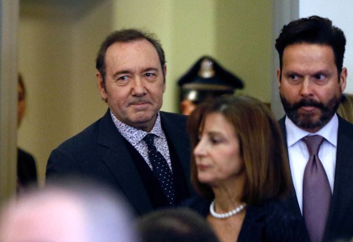 Actor Kevin Spacey enters court with his attorneys Juliane Balliro, front, and Alan Jackson, right, for arraignment on a charge of indecent assault and battery on Monday, January 7, 2019, in Nantucket.