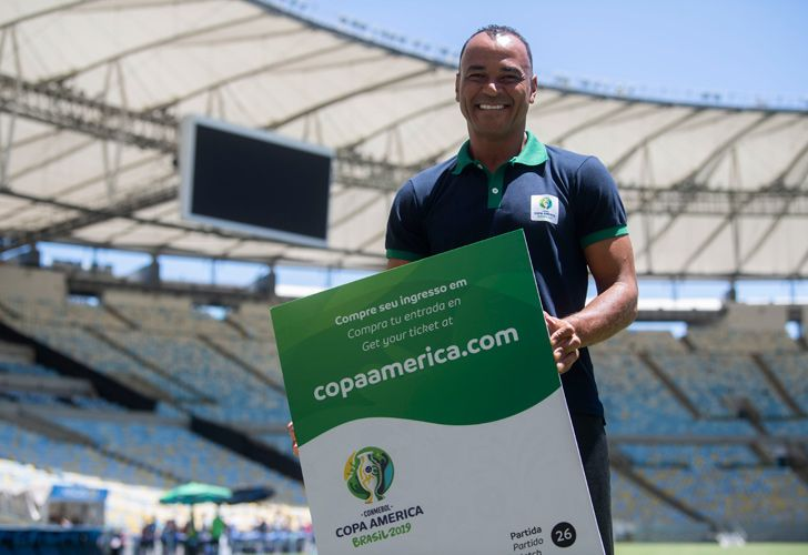 Brazilian former footballer Cafu poses for a picture showing a Copa America 2019 giant ticket after a press conference of the Copa América Local Organisation Committee, at the Maracanã Stadium in Rio de Janeiro.