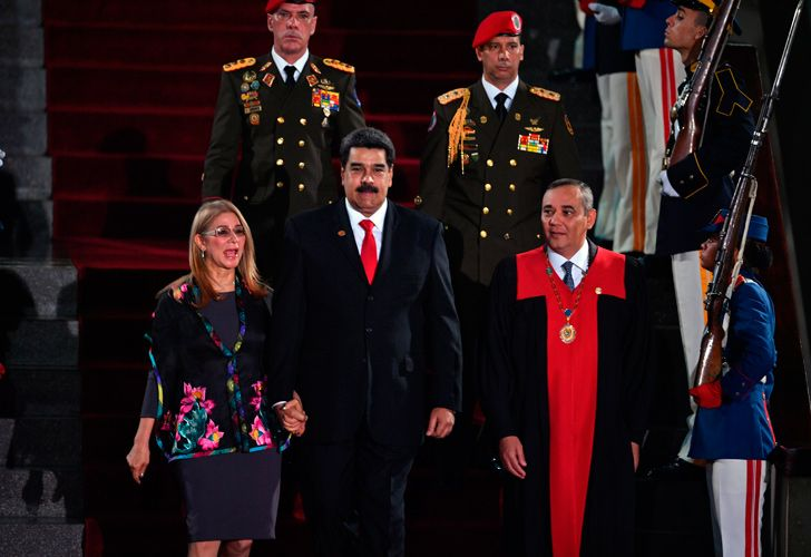 Venezuela's President Nicolás Maduro (centre) walks flanked by First Lady Cilia Flores and the president of the Supreme Court of Justice (TSJ) Maikel Moreno (right) upon arrival for the inauguration ceremony of his second mandate, at the TSJ headquarters in Caracas.