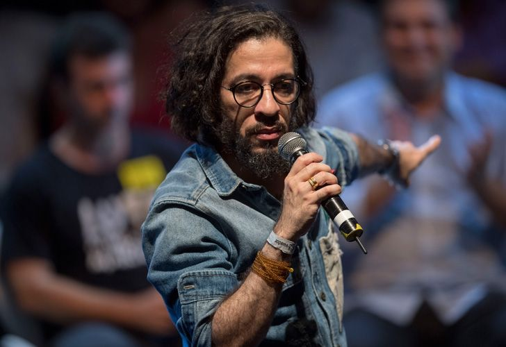 In this file picture taken on April 2, 2018, Jean Wyllys, Rio de Janeiro federal deputy for the Socialism and Liberty Party (PSOL), speaks during a rally of at Circo Voador in Rio de Janeiro, Brazil.