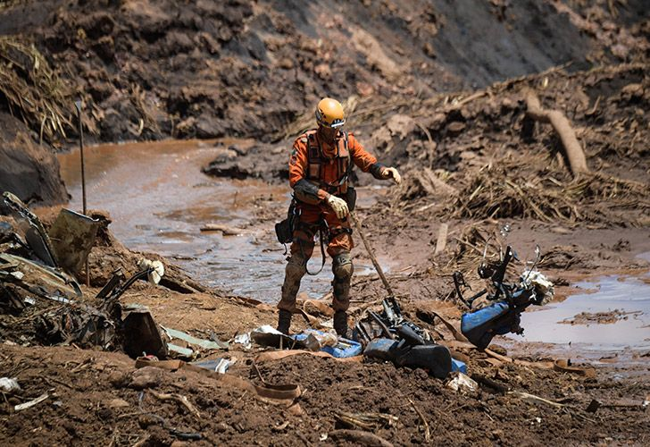 A rescuer removes debris as he works in the search for victims, four days after the collapse of a dam at an iron-ore mine belonging to Brazil's giant mining company Vale near the town of Brumadinho, state of Minas Gerais, southeastern Brazil, on January 28, 2019. The search for survivors intensified on Monday, on its fourth day, with the support of an Israeli contingent, after communities were devastated by a dam collapse that killed at least 60 people at a Brazilian mining complex -- with hopes fading for 292 still missing. A barrier at the site burst on Friday, spewing millions of tons of treacherous sludge and engulfing buildings, vehicles and roads.