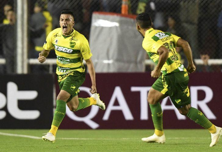 Defensa y Justicia's Leonel Miranda celebrates after scoring a goal.