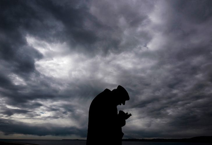 An elderly man looks at his smartphone as he stands at the Mediterranean Sea near the Promenade des Anglais in the French riviera city of Nice on February 3, 2019.