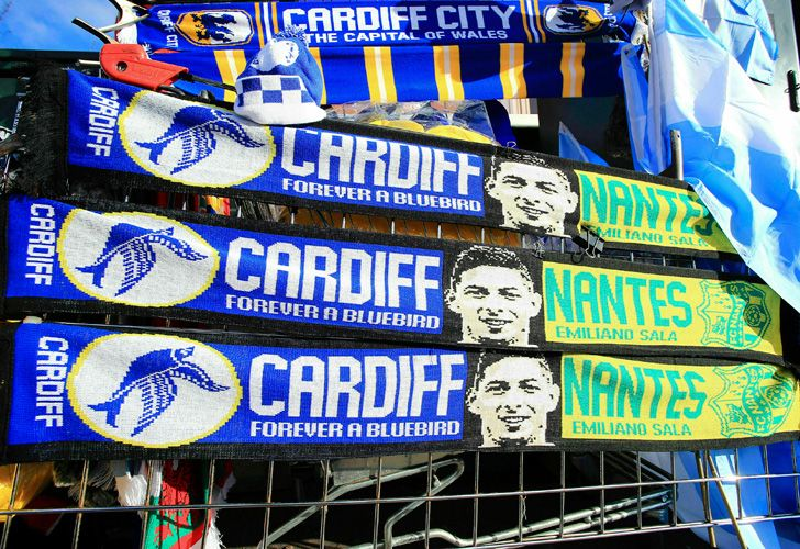 Scarves showing Emiliano Sala's image are sold outside Cardiff City's stadium.