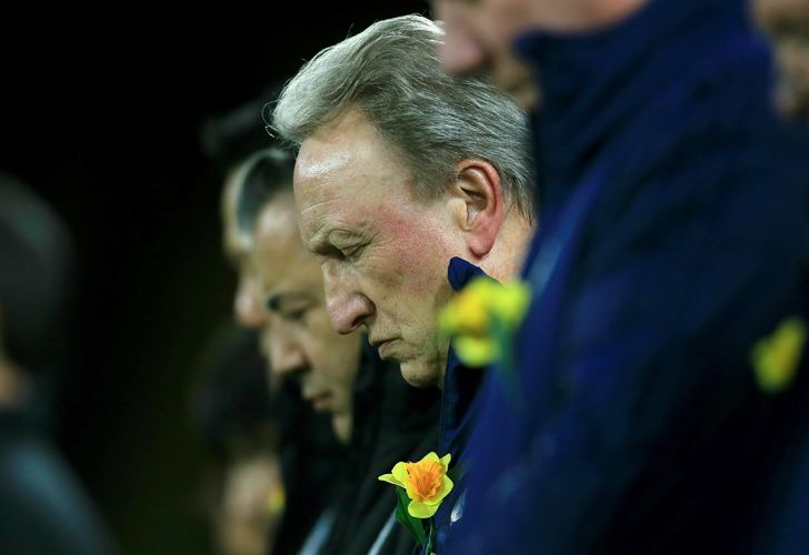 Cardiff City manager Neil Warnock during a minute of silence for Emiliano Sala ahead of the English Premier League soccer match between Cardiff and Bournemouth at the Cardiff City Stadium, in Cardiff, Wales, Saturday, Feb. 2, 2019.