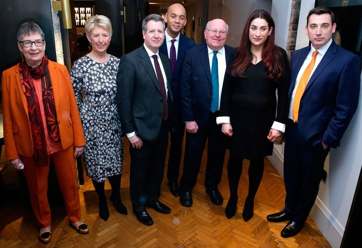Former Labour party MPs, (from left) Ann Coffey, Angela Smith, Chris Leslie, Chuka Umunna, Mike Gapes, Luciana Berger, and Gavin Shuker pose for a photograph following a press conference in London on February 18, 2019, where they announced their resignation from the Labour Party, and the formation of a new independent group of MPs.