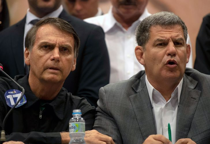 In this file picture taken on October 11, 2018 the presidential candidate of Brazil's right-wing Social Liberal Party (PSL), Jair Bolsonaro (L), and the president of the PSL, Gustavo Bebianno, offer a press conference in Rio de Janeiro, Brazil. Brazilian President Jair Bolsonaro on February 18, 2019 sacked a close aide who helped get him elected, Gustavo Bebianno, after a storm within their ruling PSL party over suspected improper campaign financing. Bolsonaro