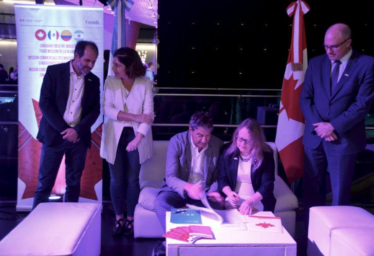 Valerie Creighton, President and CEO of the Canada Media Fund, signs a co-production treaty with National Institute for Film and Audiovisual Arts President Ralph Haiek at the reception Monday.