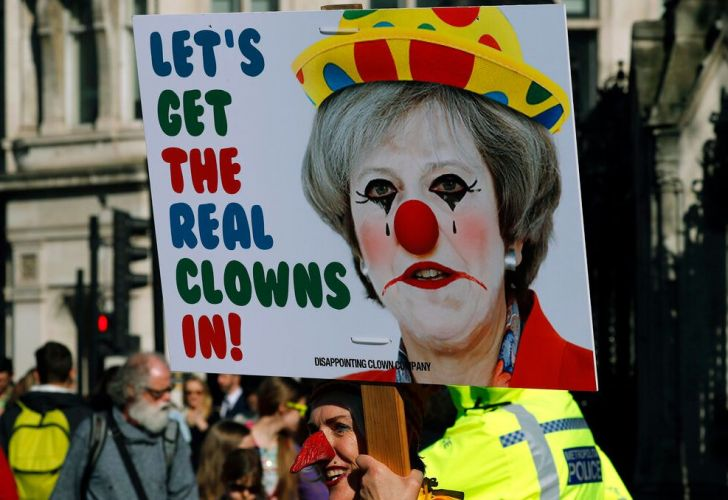 A Demonstrator protests at the entrance of the Houses of Parliament in London, Tuesday, Feb. 26, 2019.