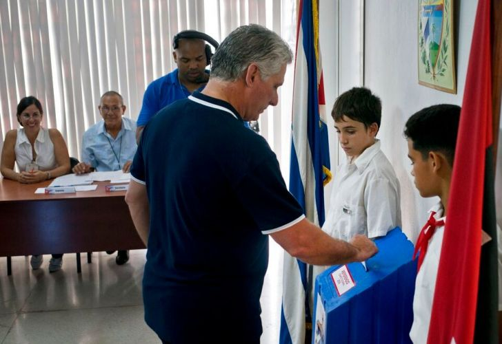 Cuba's President Miguel Diaz-Canel votes during a referendum to approve or reject the new constitution in Havana, Cuba.