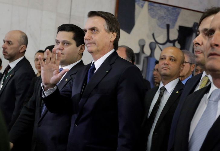 Brazil's President Jair Bolsonaro, centre, arrives at the National Congress to deliver a proposal to overhaul Brazil's pension system, in Brasilia.