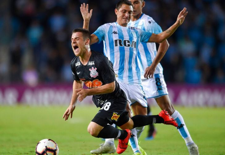 Ramiro of Brazil's Corinthians, left, falls as he fights for the ball with Nery Cardozo of Argentina's Racing Club, hands up, during a Copa Sudamericana soccer match in Buenos Aires, Argentina, Wednesday, Feb. 27, 2019.