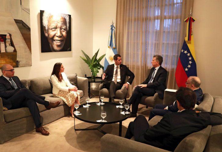 Venezuela's self-proclaimed interim president Juan Guaidó (centre-left) left, speaks with Mauricio Macri at the Olivos presidential residence.