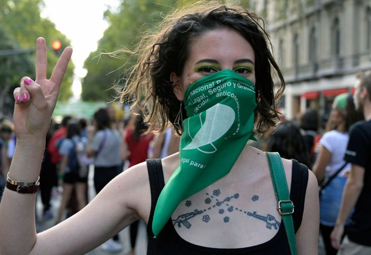 A woman takes part in a demonstration during the International Women's day in Buenos Aires on March 8, 2019. Protests, strikes and studies -- people around the globe are taking action to mark International Women's Day and to push for action to to obtain equality.