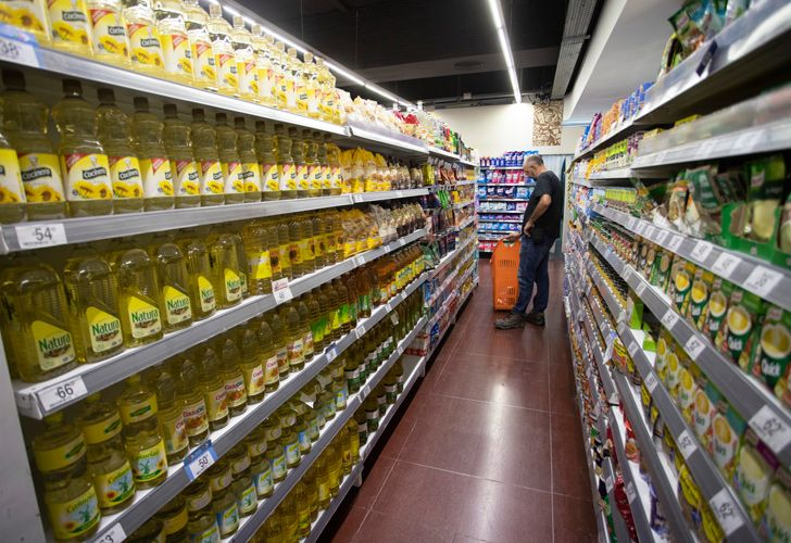 A shopper checks prices in a Carrefour supermarket in the capital.