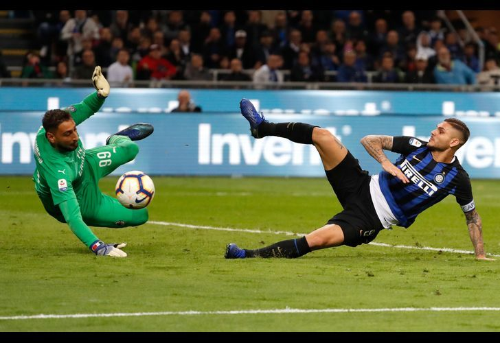 Mauro Icardi of Inter Milan, tries to score over AC Milan goalkeeper Gianluigi Donnarumma during the Serie A football match held on October 21, 2018, at the San Siro Stadium, in Milan, Italy.