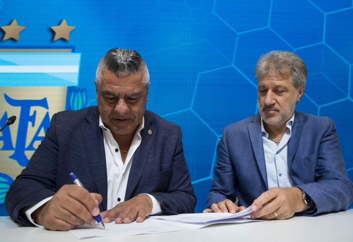 Claudio Tapia, president of Argentina's Soccer Federation, signs the contract to implement a plan to professionalize Argentine women's soccer in Buenos Aires on Saturday.