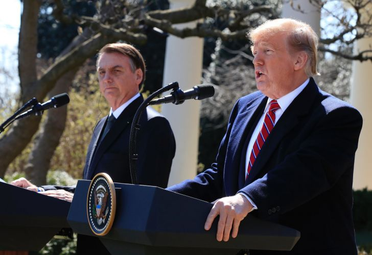 President Donald Trump and visiting Brazilian President Jair Bolsonaro speak during a news conference in the Rose Garden of the White House, Tuesday, March 19, 2019, in Washington.