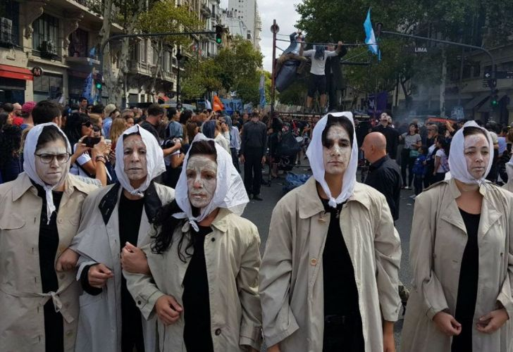 Artists depict the Mothers of Plaza de Mayo during the 43rd anniversary of the 1976 military coup d'état.