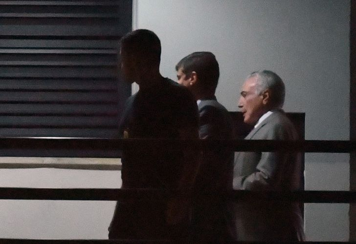 Brazil's former president Michel Temer, arrives under police escort at the Federal Police headquarters in Rio de Janeiro, Brazil, on March 21.