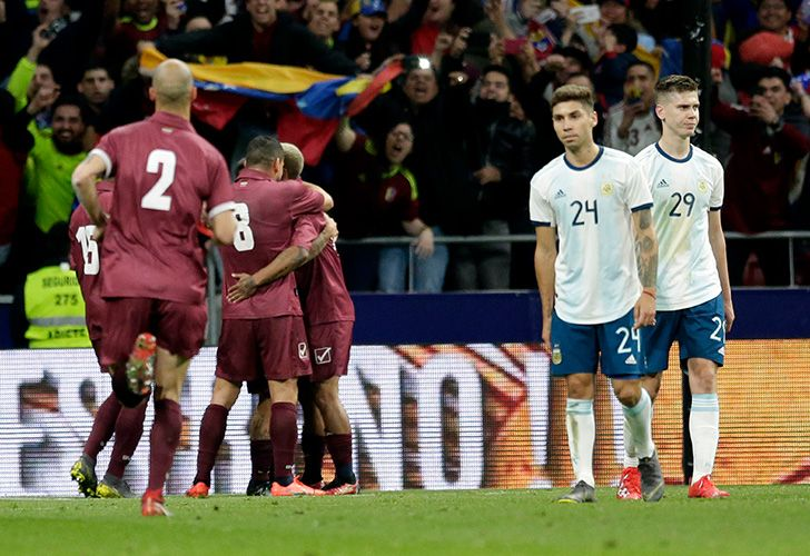 Venezuela's players, left, celebrated the third goal against Argentina during their international friendly football match at the Wanda Metropolitano stadium in Madrid, Spain, Friday, March 22, 2019.