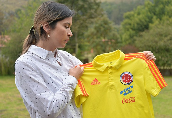 Physiotherapist Carolina Rozo, former physio of the Colombian under-17 national football team, shows a jersey of the team during an interview to AFP in Bogota, on April 3, 2019. Accusations of sexual abuse and harassment in Colombian women's football have started to be unveiled, followed by a handful of allegations by referees that enlarged the scandal. Rozo has claimed that for having rejected the team's former coach advances in December 2017 she suffered professional retaliation that caused her depression.