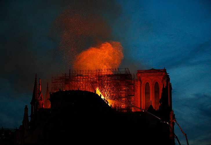Firefighters use hoses as Notre Dame cathedral burns in Paris, Monday, April 15, 2019. A catastrophic fire engulfed the upper reaches of Paris' soaring Notre Dame Cathedral as it was undergoing renovations Monday, threatening one of the greatest architectural treasures of the Western world as tourists and Parisians looked on aghast from the streets below.