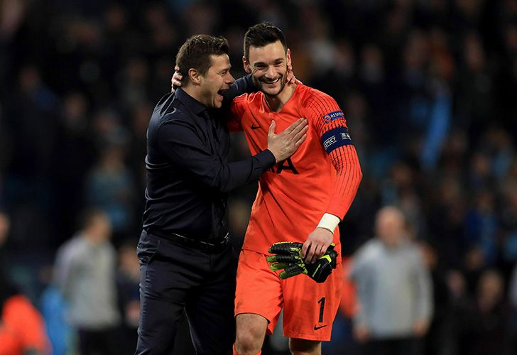 Tottenham Hotspur manager Mauricio Pochettino and goalkeeper Hugo Lloris celebrate after the Champions League quarter-final second leg match at the Etihad Stadium, Manchester, England, Wednesday April 17, 2019.