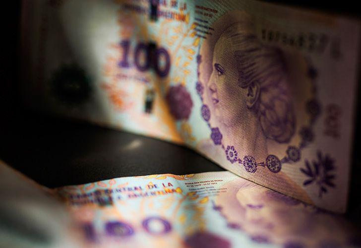 100-peso bills.