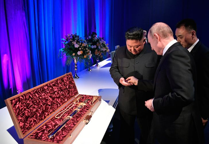 Russian President Vladimir Putin and North Korean leader Kim Jong Un exchange gifts following their talks at the Far Eastern Federal University campus on Russky island in the far-eastern Russian port of Vladivostok on April 25, 2019.