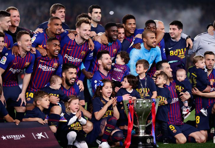 Barcelona's players celebrate winning the league title.