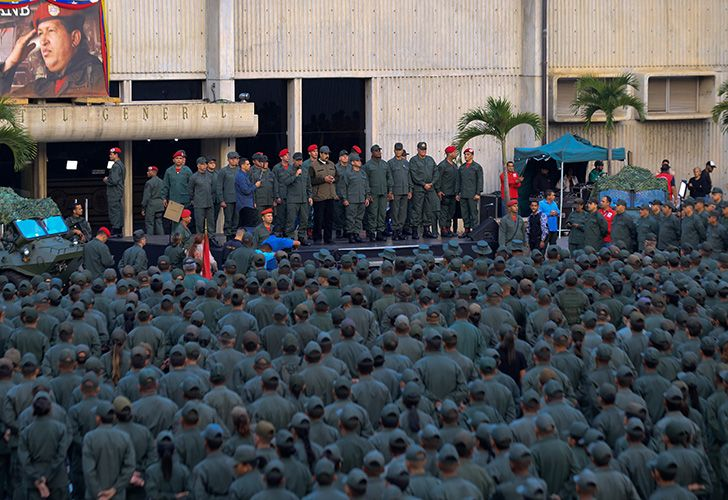 This handout picture released by Miraflores Palace press office shows Venezuela's President Nicolás Maduro delivering a message to loyal troops at the
