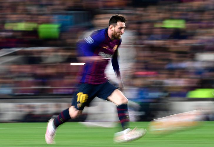 Barcelona forward Lionel Messi runs with the ball during the UEFA Champions League semi-final first leg football match between Barcelona and Liverpool at the Camp Nou Stadium in Barcelona on May 1, 2019.