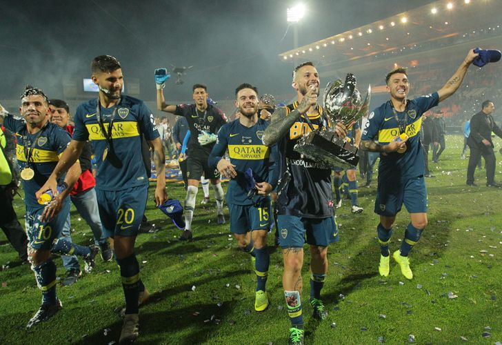 Boca Juniors players celebrating after clinching the Supercopa Argentina title.